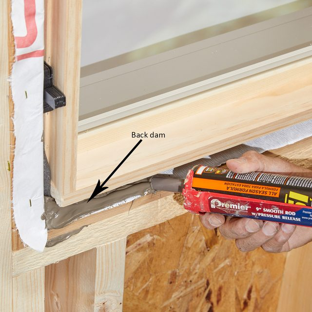 Create a back dam with window sealant | Construction Pro Tips
