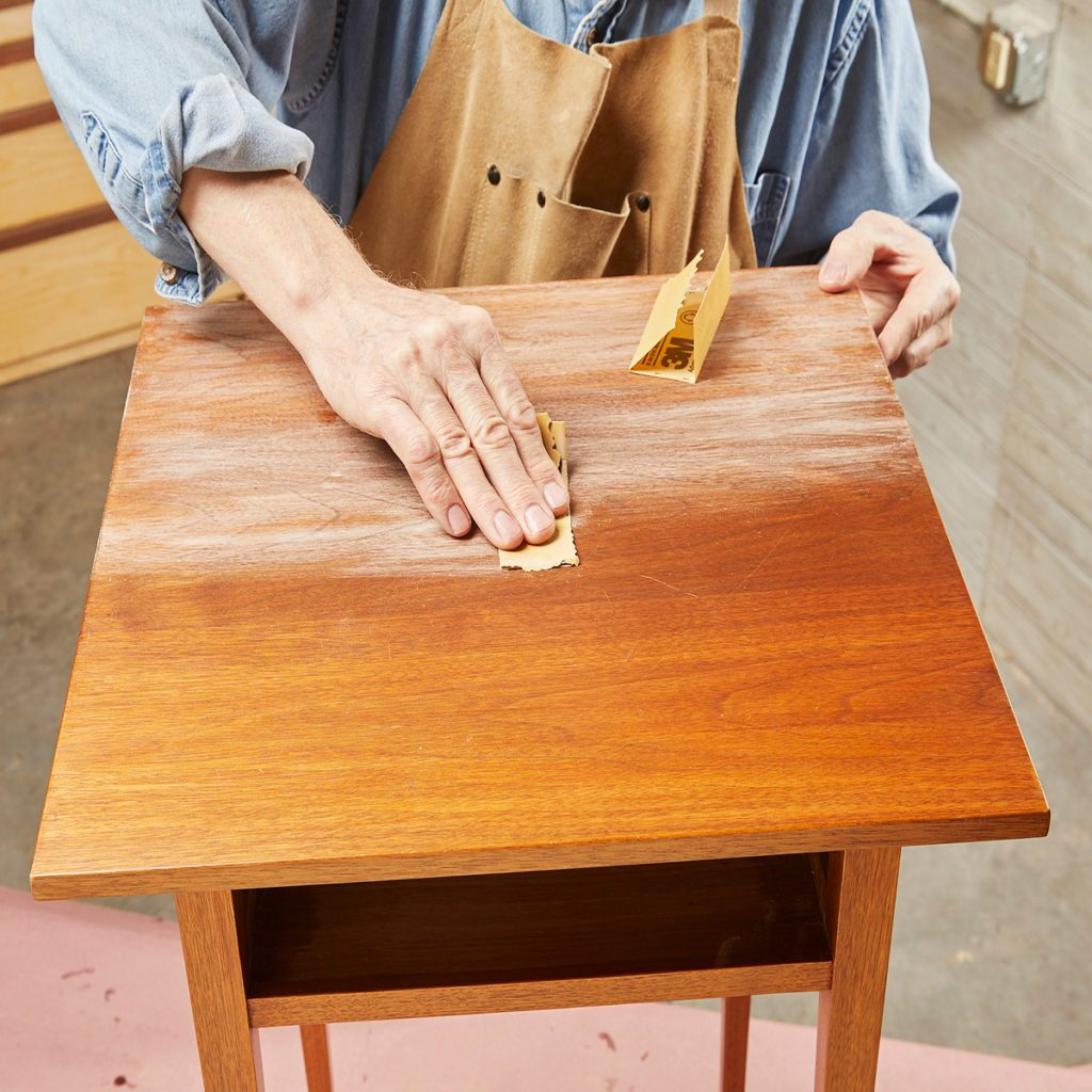 Hand sanding end table top | Construction Pro Tips