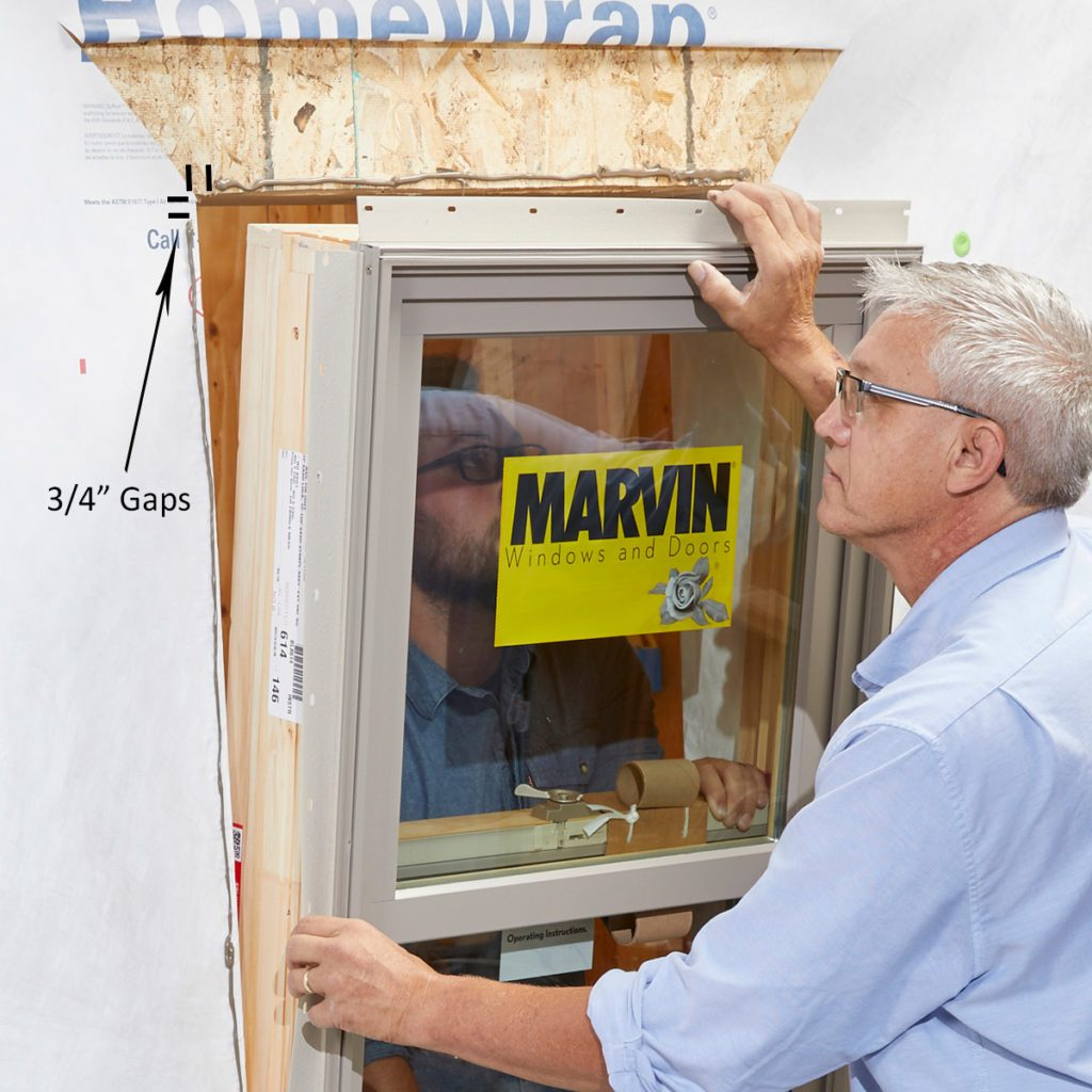 Sealing the sides and tops of the window with sealant   Construction Pro Tips