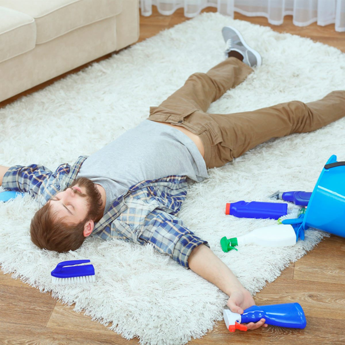 guy cleaning rug