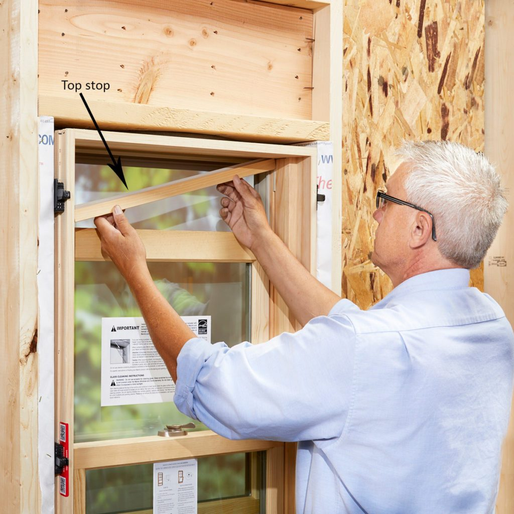 Expert straightening the jambs of a window   Construction Pro Tips