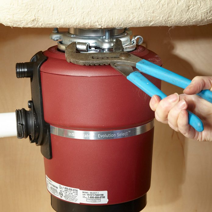 Replace a Garbage Disposal tighten with pliers