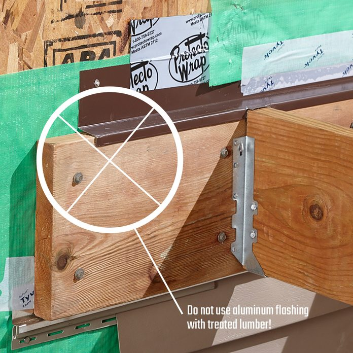 Ledger board covered by metal flashing | Construction Pro Tips