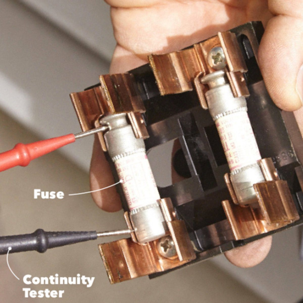 Checking to see if fuses are burnt out with continuity tester | Construction Pro Tips