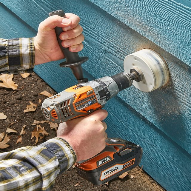 Drilling into siding with a hole saw
