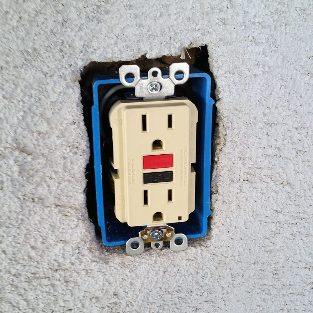 Bare outlet in a stucco wall | Construction Pro Tips