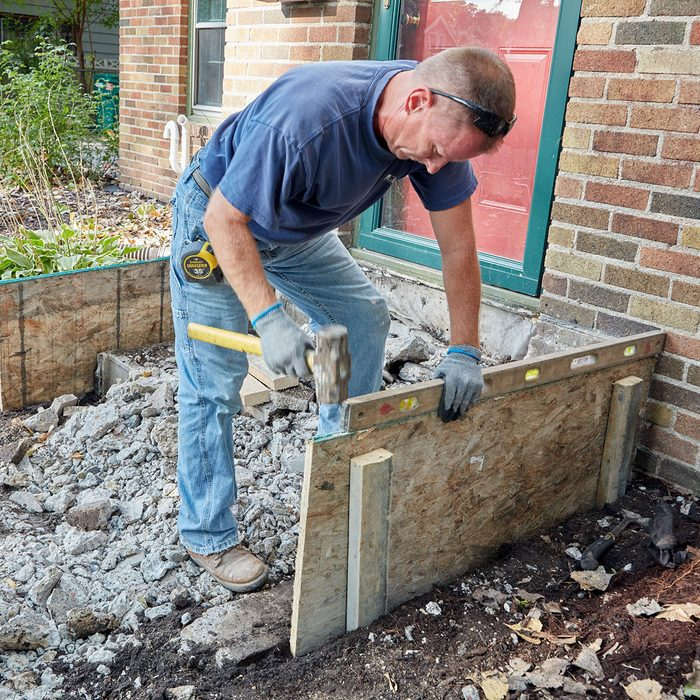 Making sure that the forms are plumb and level   Construction Pro Tips