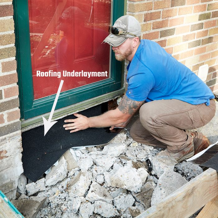 Placing underlayment to protect house   Construction Pro Tips