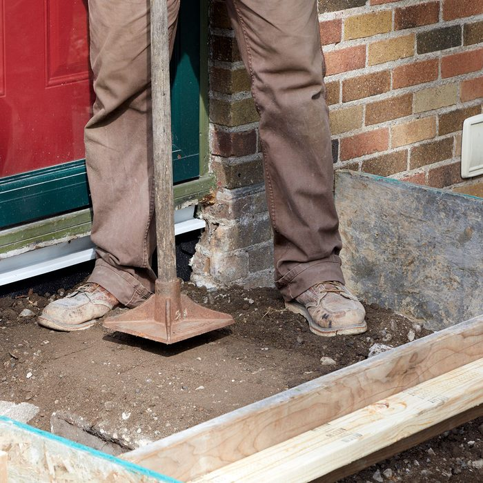 Tamping down the loose fill   Construction Pro Tips