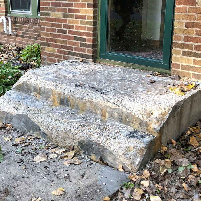 A worn-down old concrete step   Construction Pro Tips