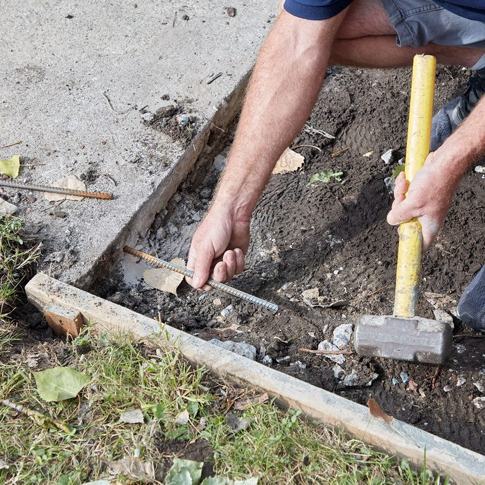 Tying into the existing sidewalk with rebar   Construction Pro Tips