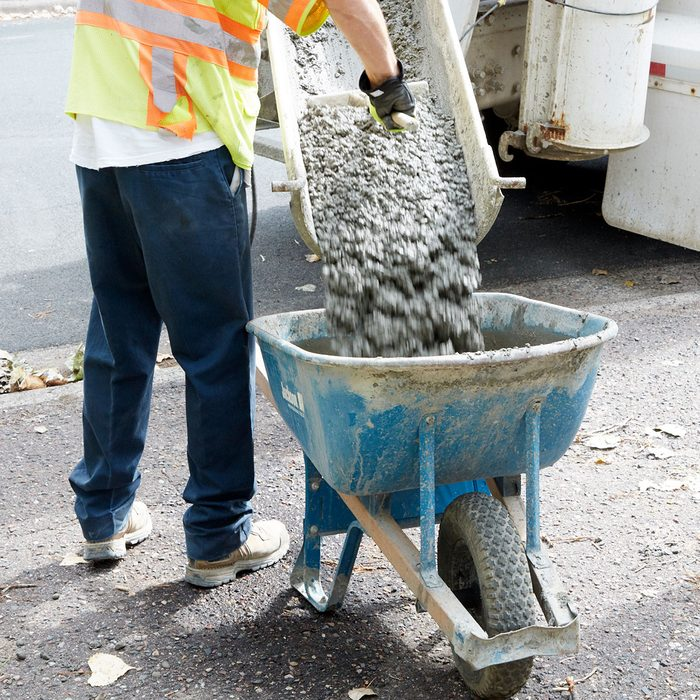 Concrete being poured out at a thick consistency   Construction Pro Tips