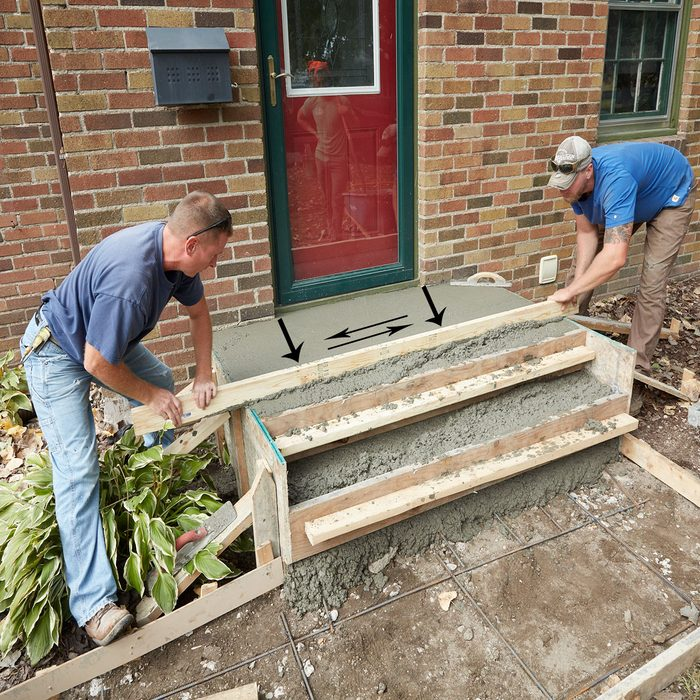 Screed away the top of the form   Construction Pro Tips
