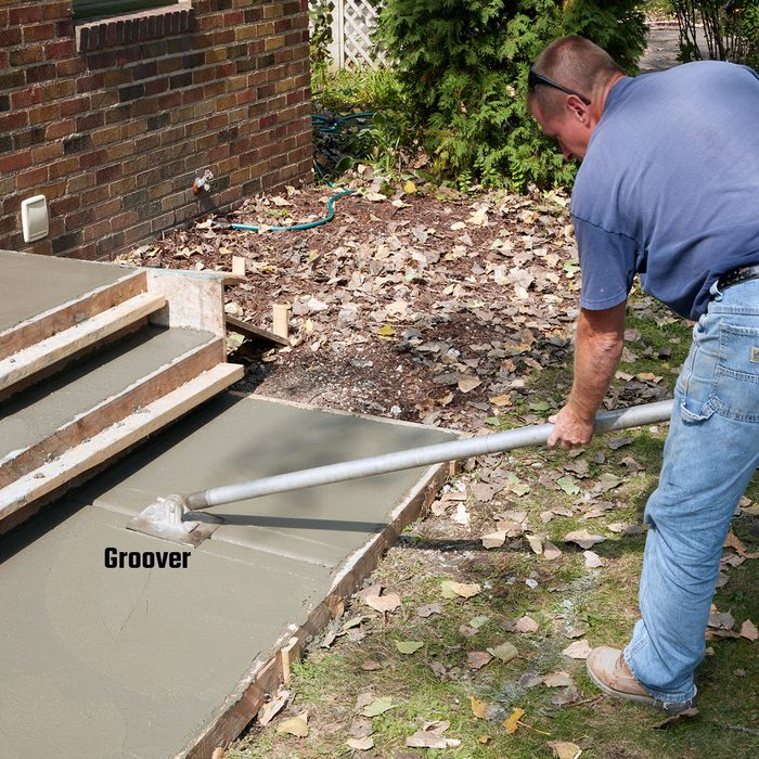Create control joints with a groover   Construction Pro Tips