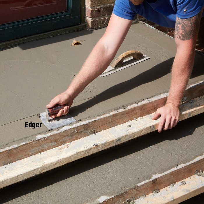 Rounding off the edges with an edger   Construction Pro Tips