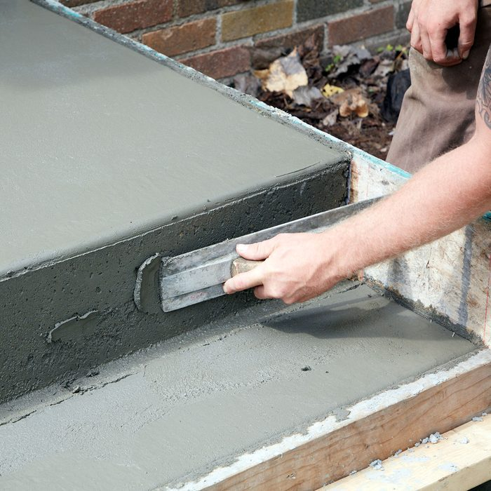 Fill any voids with leftover concrete   Construction Pro Tips