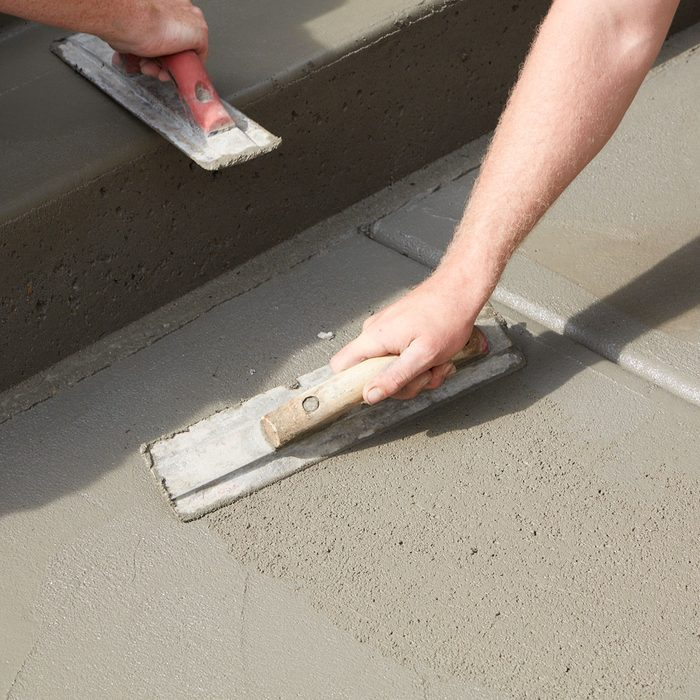 Smoothing out concrete and filling in voids   Construction Pro Tips