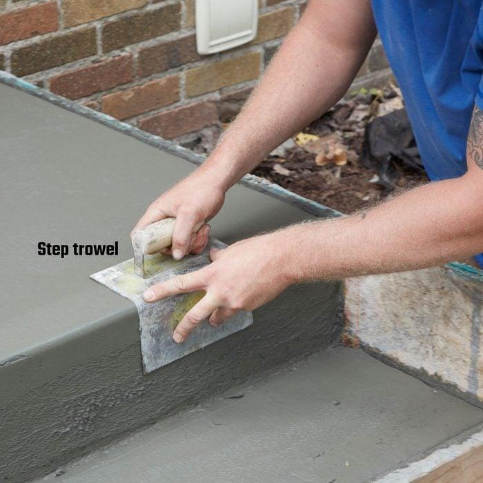 Troweling the edges of concrete steps   Construction Pro Tips