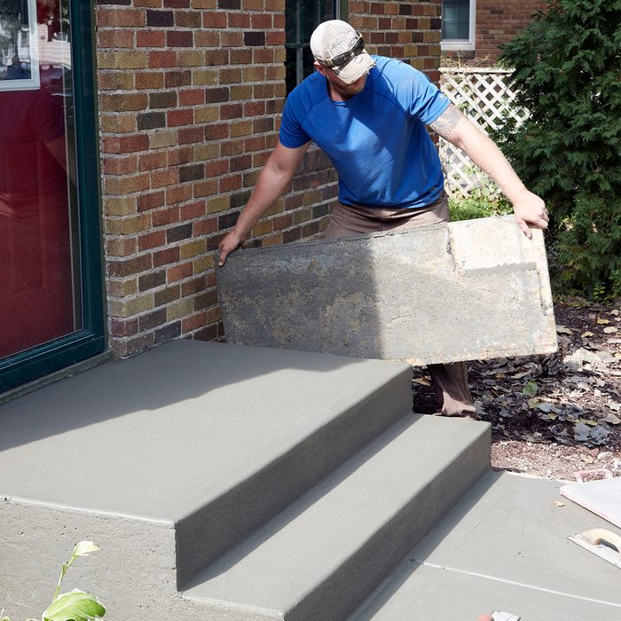 Pulling the side forms when the step is dry enough   Construction Pro Tips