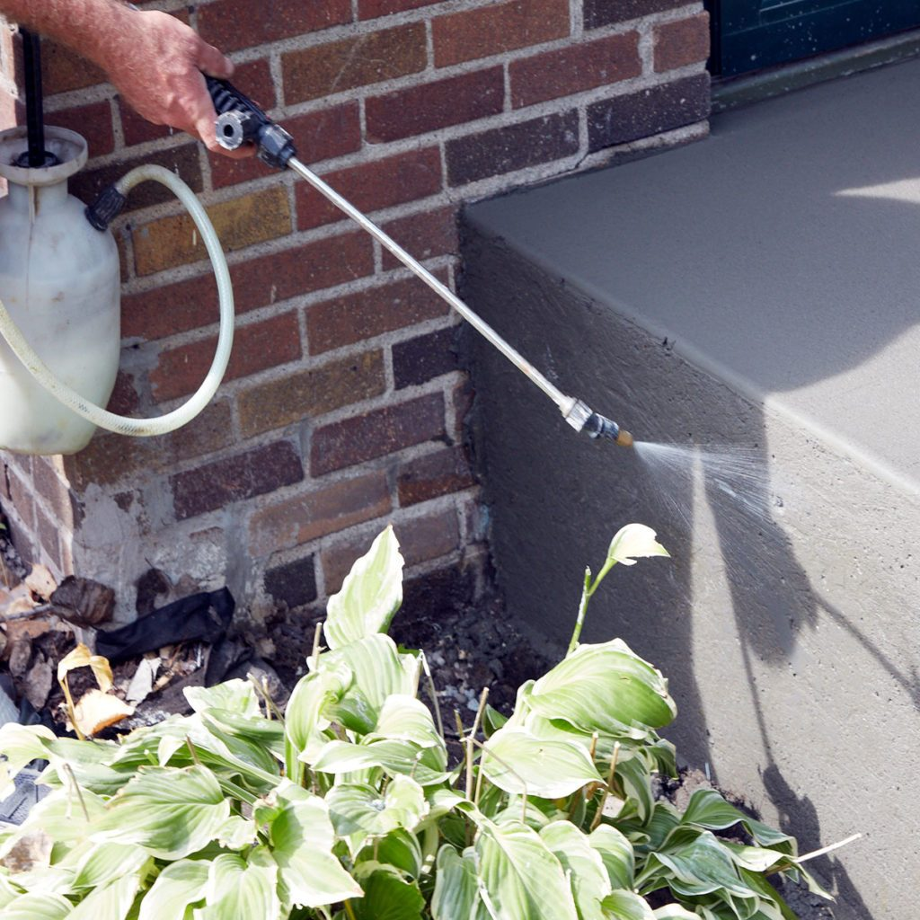 Spraying evaporation retardent onto the poured steps | Construction Pro Tips