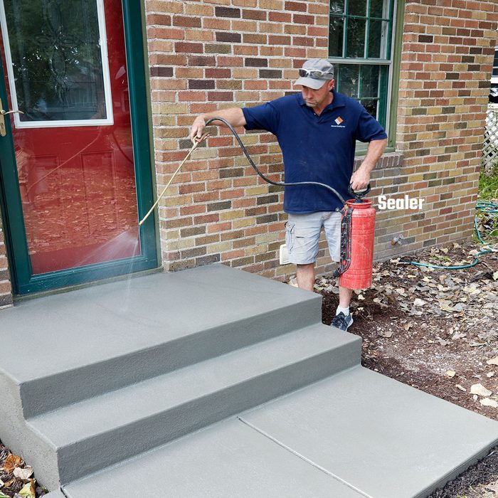 Man sealing a step with Concrete Sealer   Construction Pro Tips