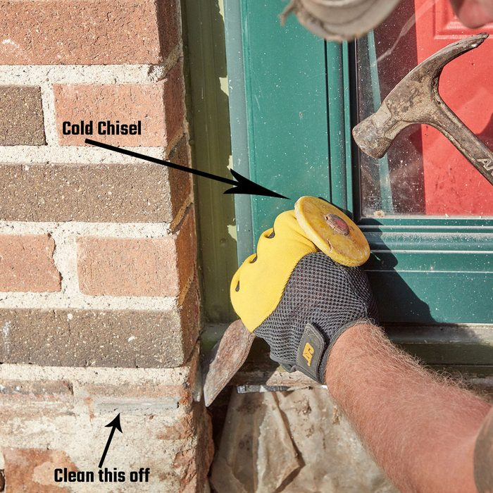 Cleaning the top edge with a cold chisel   Construction Pro Tips