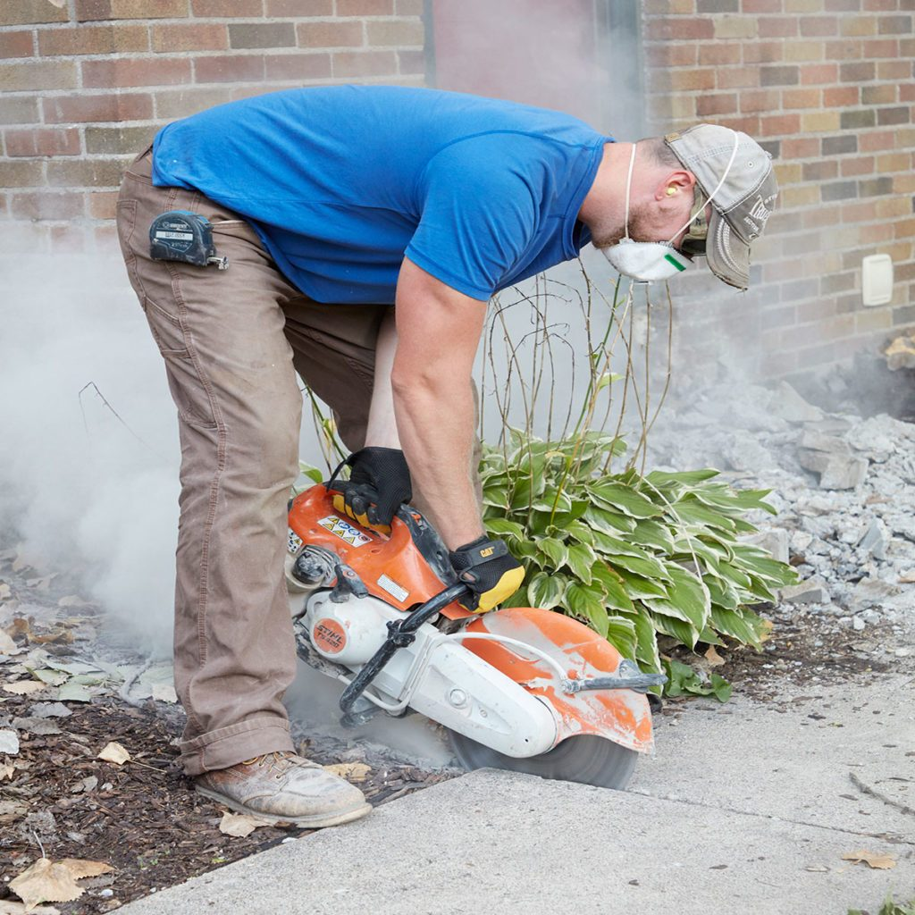 Slicing away from the sidewalk with a concrete saw | Construction Pro Tips