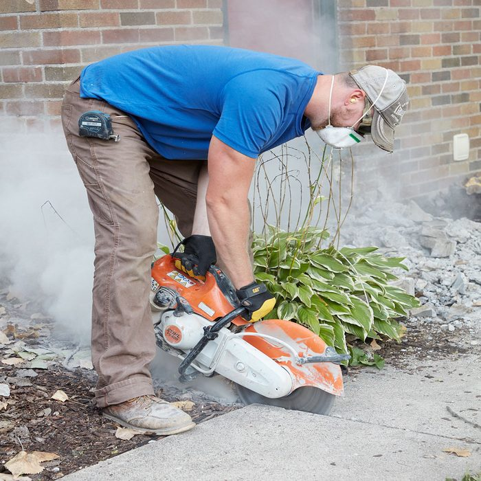Slicing away from the sidewalk with a concrete saw   Construction Pro Tips