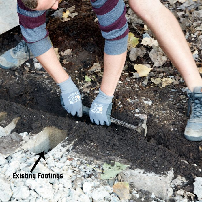Digging a trench with a hammer for footings   Construction Pro Tips