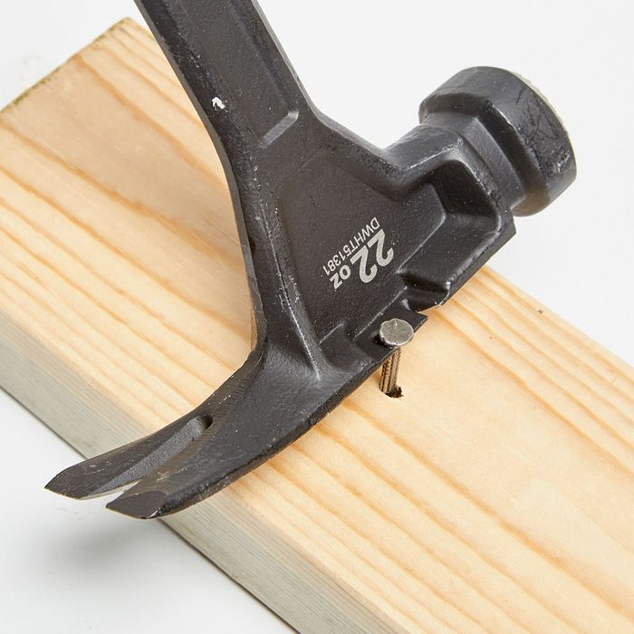 Nail being pulled by hammer with side-puller | Construction Pro Tips