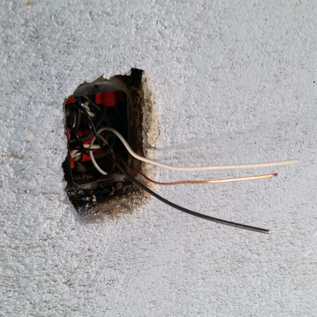 New pigtails and connectors poking out of outlet cavity | Construction Pro Tip