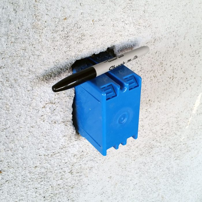 Sharpie resting on temporary outlet box | Construction Pro Tip