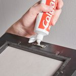 Why You Should Use Toothpaste to Hang a Picture