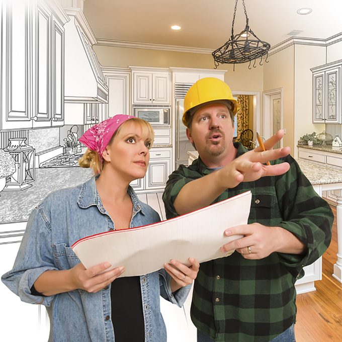 Contractor and homeowner looking over plans | Construction Pro Tips