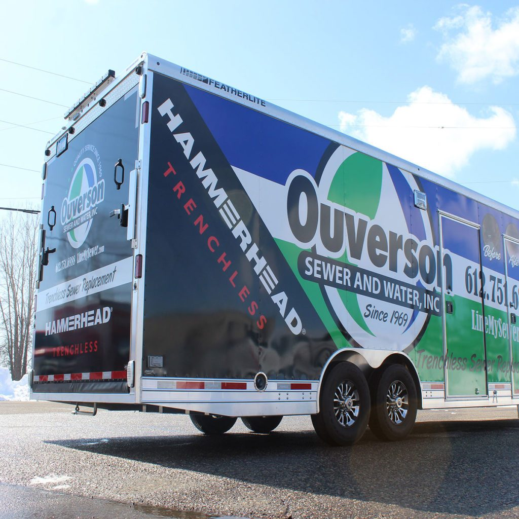 Back end of a trailer covered in decals | Construction Pro Tips