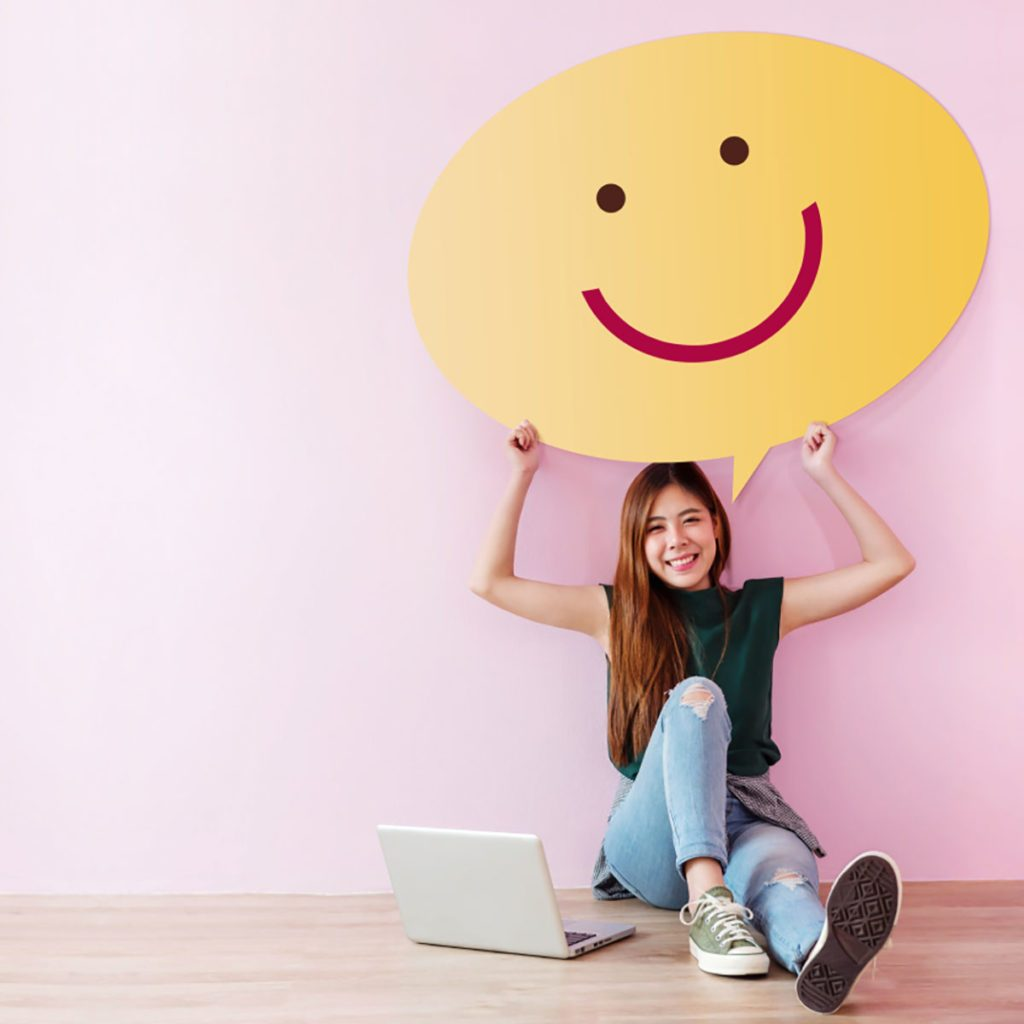 Happy customer holding a giant smiley over her head | Construction Pro Tips