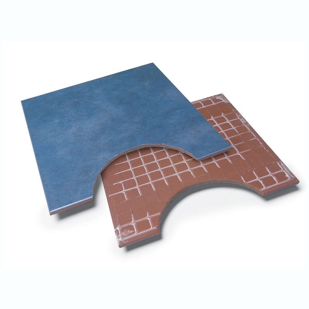 Semi-circular cuts in the edge of two pieces of tile   Construction Pro Tips
