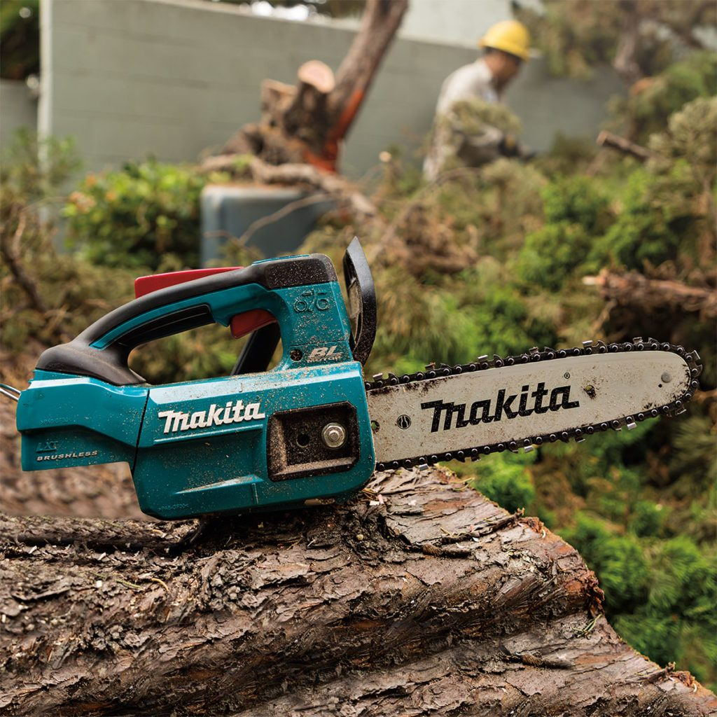 Makita Chain Saw Resting on a Log | Construction Pro Tips