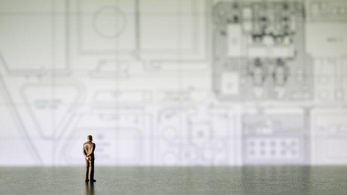 businessman miniature people looking diagram