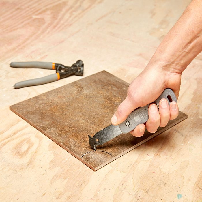 Cutting a groove in tile | Construction Pro Tips