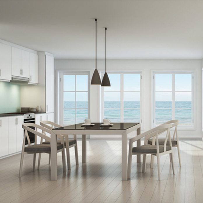 Sea view dining, living room and kitchen in beach house