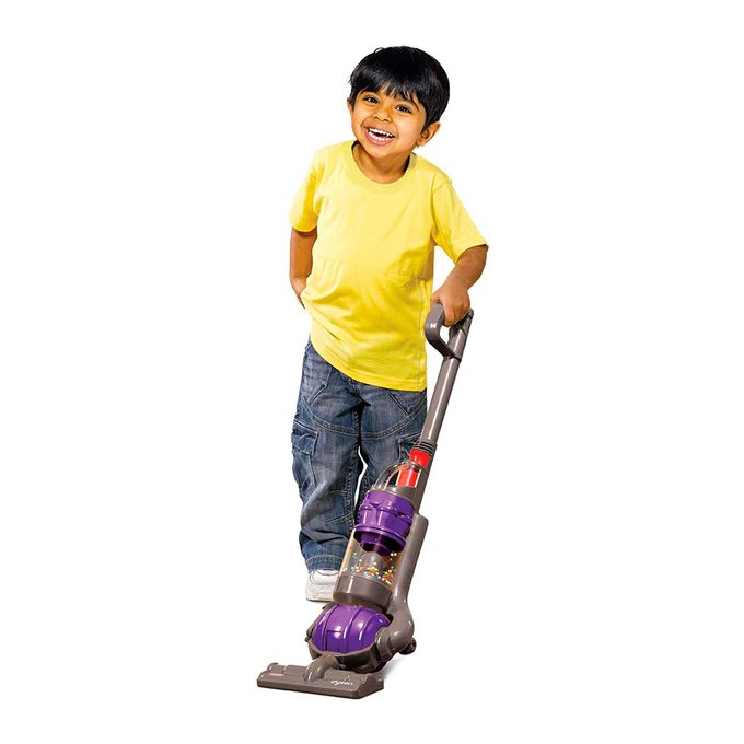 child with dyson vacuum