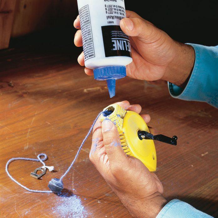 Loading blue chalk into a chalkline | Construction Pro Tips
