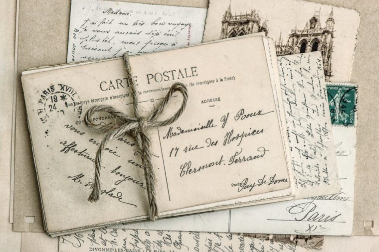 old letters and antique french postcards. vintage sentimental retro style background