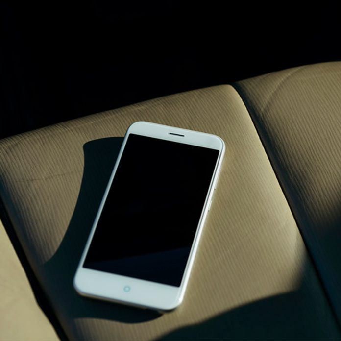cell phone on seat of car