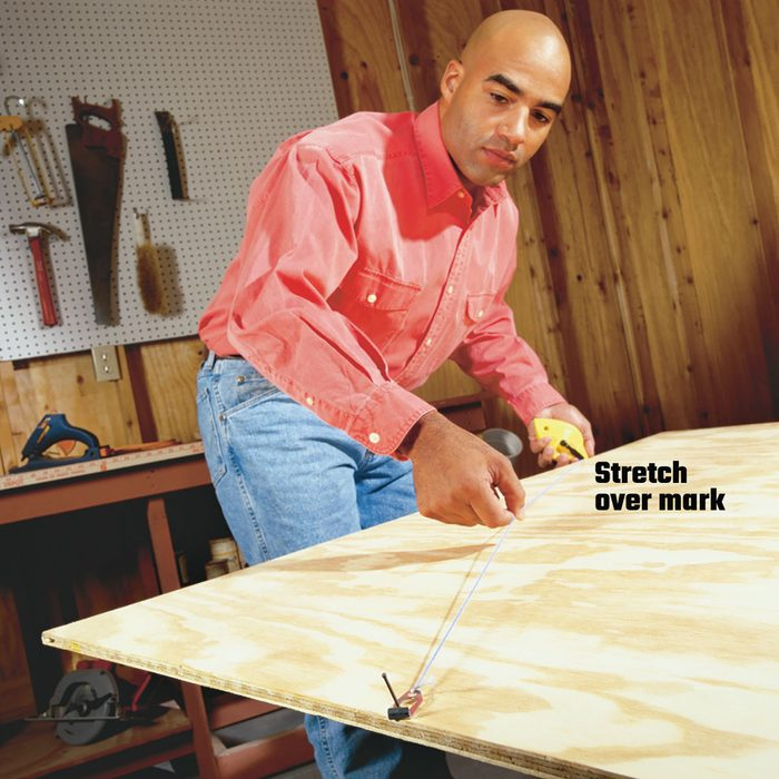 Stretching past a mark to make a line with a chalkline | Construction Pro Tips