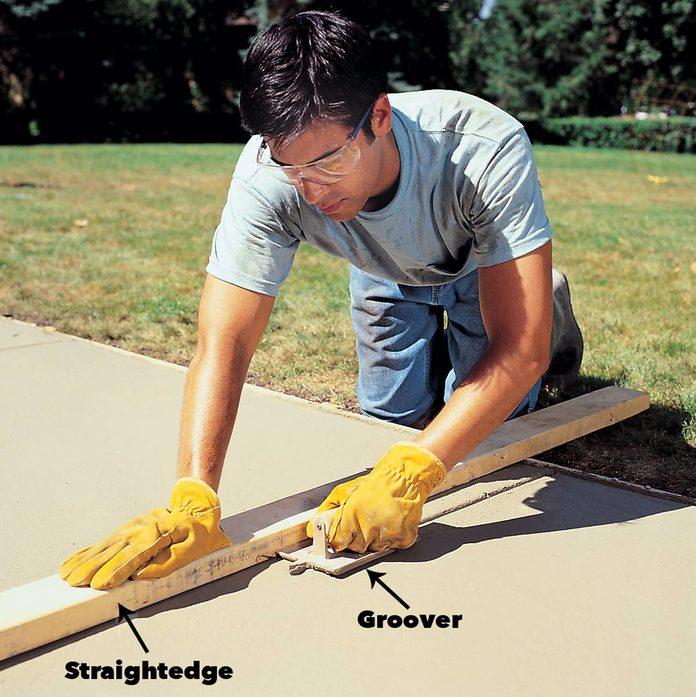 cut control joints concrete sidewalk
