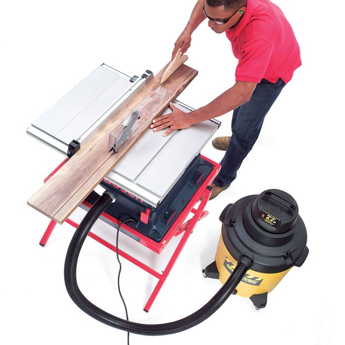 Cutting on a table saw with a vacuum attached | Construction Pro Tips
