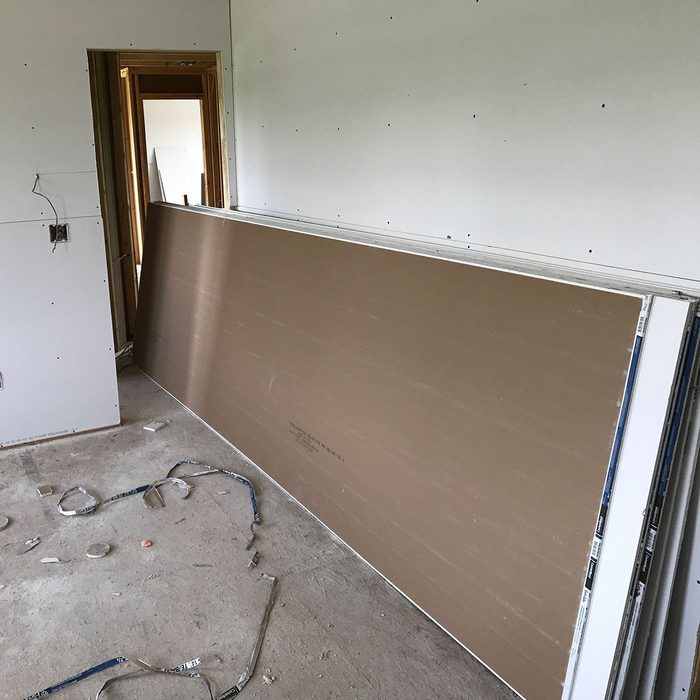 Long drywall sticking out of a door   Construction Pro Tips