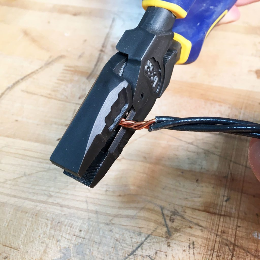Clipping wires with linesmans pliers | Construction Pro Tips
